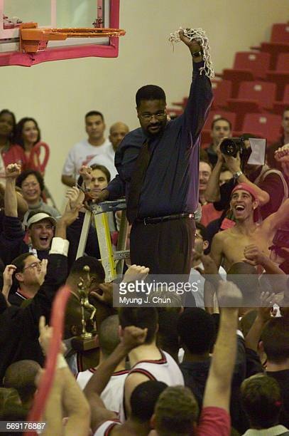 CSUN basketball coach Bobby Braswell displays the souvenir net to a gathered crowd following their victory over Eastern Washington Saturday night...