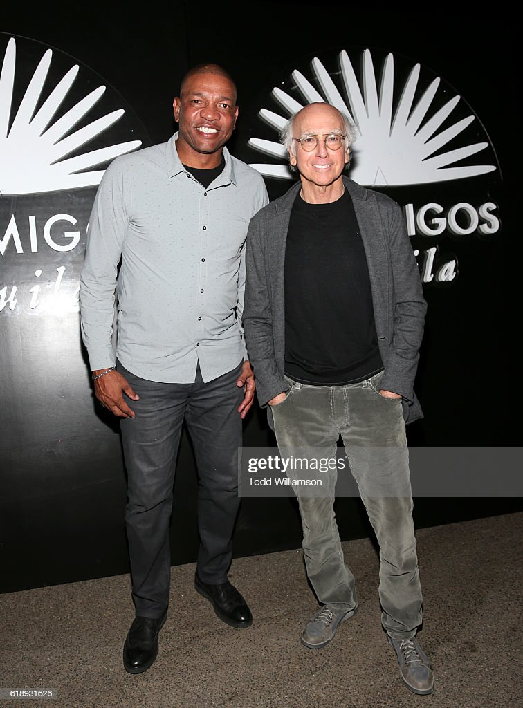 Basketball coach Doc Rivers and writer Larry David arrive to the Casamigos Halloween Party at a private residence on October 28, 2016 in Beverly Hills, California.