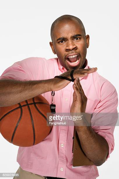 Basketball coach signaling time out, on white background