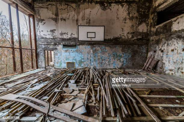 Basketball court in an abandoned school. Prypiat, Ukraine