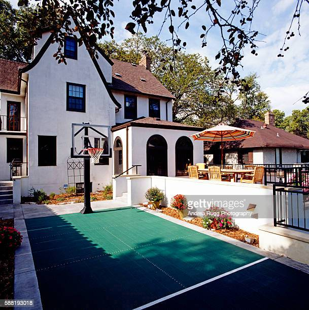 A basketball court is seen outside a residential building