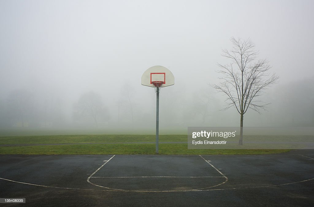 Basketball court on a foggy day : Stock Photo