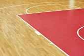Basketball court parquet in indoors sport gym