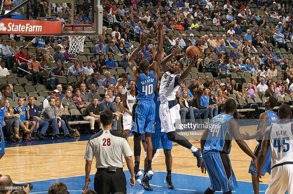 Dallas Mavericks Bernard James (5) in action vs Orlando Magic Mickell Gladness (40) during preseason game at American Airlines Center. Greg Nelson F39 )