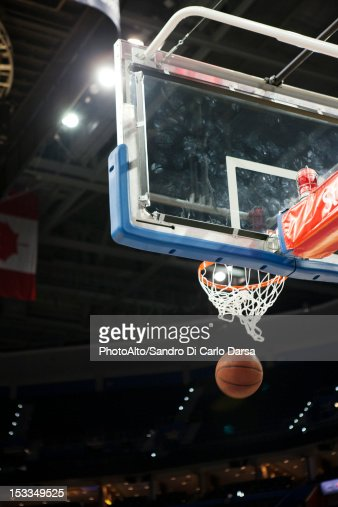 Basketball falling through hoop