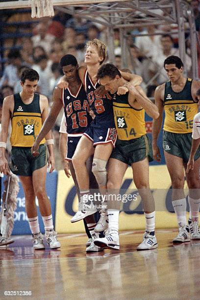 FIBA World Championship USA Steve Kerr helped off the court after injury by Charles Smith and Brazil Oscar Schmidt during Semifinals vs Brazil at...