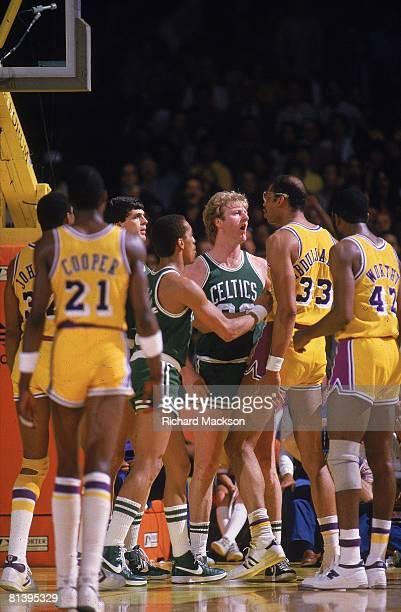 Basketball finals Los Angeles Lakers Kareem AbdulJabbar upset arguing during game vs Boston Celtics Larry Bird Los Angeles CA 6/3/19846/10/1984