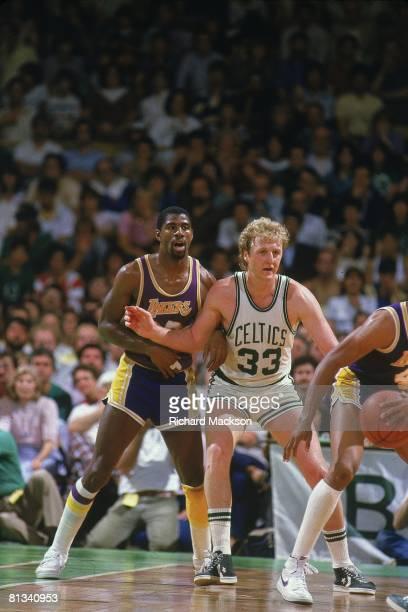 Basketball finals Los Angeles Lakers Magic Johnson in action fighting for position vs Boston Celtics Larry Bird Boston MA 5/27/1984