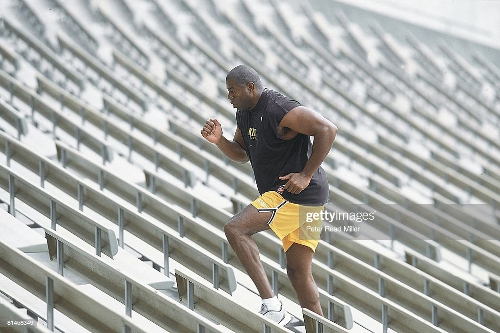Basketball Former Los Angeles Laker Earvin Magic Johnson in action running steps at UCLA's Drake Stadium Los Angeles CA 7/10/2001