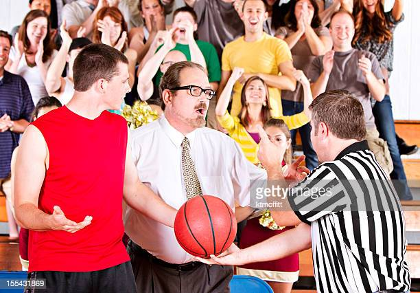 Basketball Game Argument in Front of Crowd