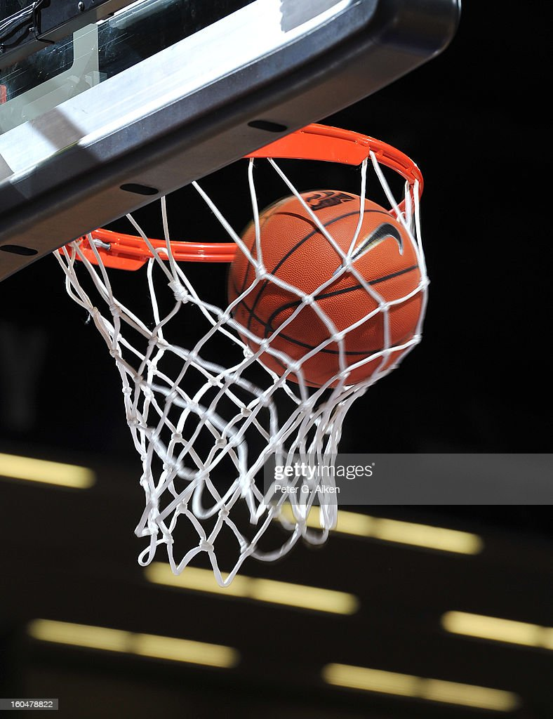 A basketball goes through the basket during a game between the Kansas State Wildcats and the Texas Longhorns on January 30, 2013 at Bramlage Coliseum in Manhattan, Kansas.