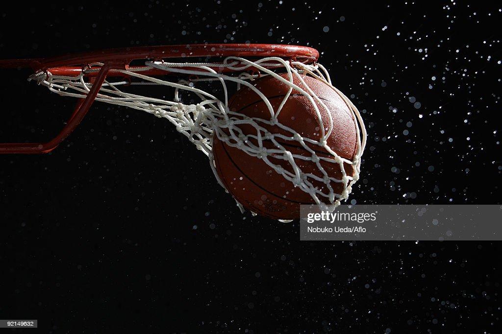Basketball going through hoop
