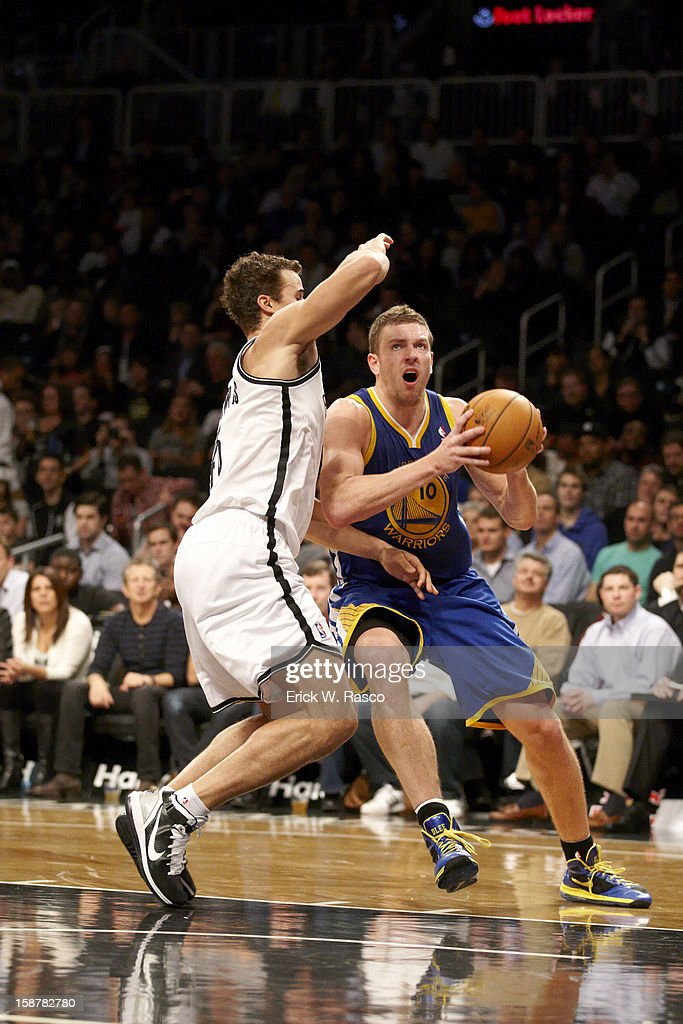 Golden State Warriors David Lee (10) in action vs Brooklyn Nets Kris Humphries (43) at Barclays Center. Erick W. Rasco F116 )