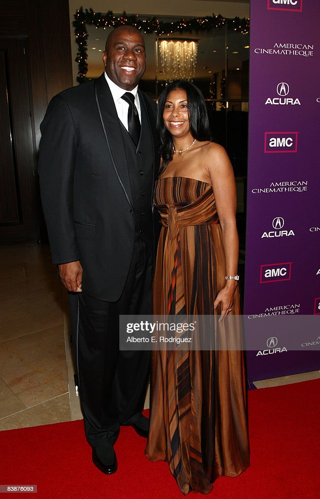 Basketball great Earvin 'Magic' Johnson (L) and wife Earlitha 'Cookie' Johnson arrive at the 23rd annual American Cinematheque show honoring Samuel L. Jackson held at Beverly Hilton Hotel on December 1, 2008 in Beverly Hills, California.
