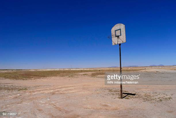 Basketball hoop in an arid field, Bolivia