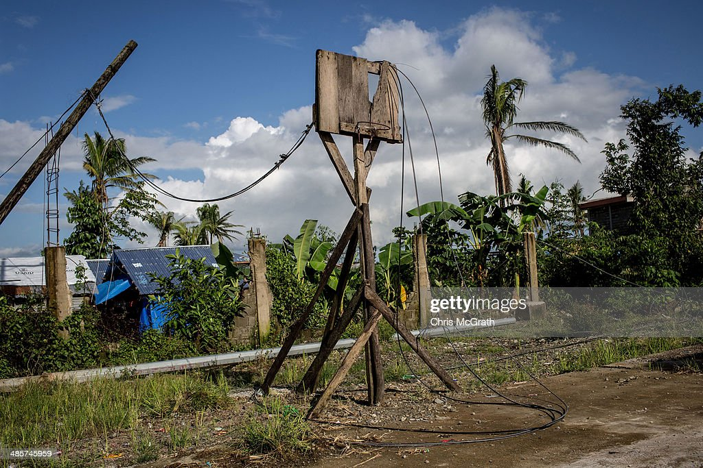 A basketball hoop is seen on April 19, 2014 in Santa Fe, Leyte, Philippines. Basketball is the most popular sport in the Philippines. In the aftermath of Superstorm Yolanda that struck the coast on November 8, 2013 leaving more than 6000 dead and many more homeless, basketball hoops were some of the first things to be repaired and rebuilt amongst the rubble, showing the Filipino's resilience and intense love for the sport. Five months after the storm, basketball courts have re-emerged in large numbers across the damaged provinces using any available space and many being rebuilt from storm debris.
