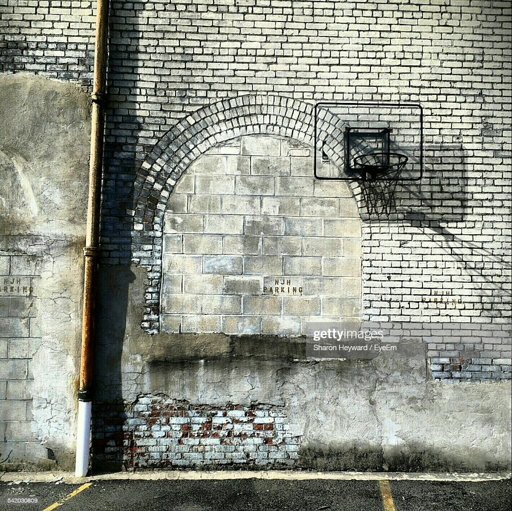 basketball hoop on brick wall of building stock photo getty images