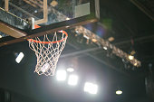Basketball hoop, night game.