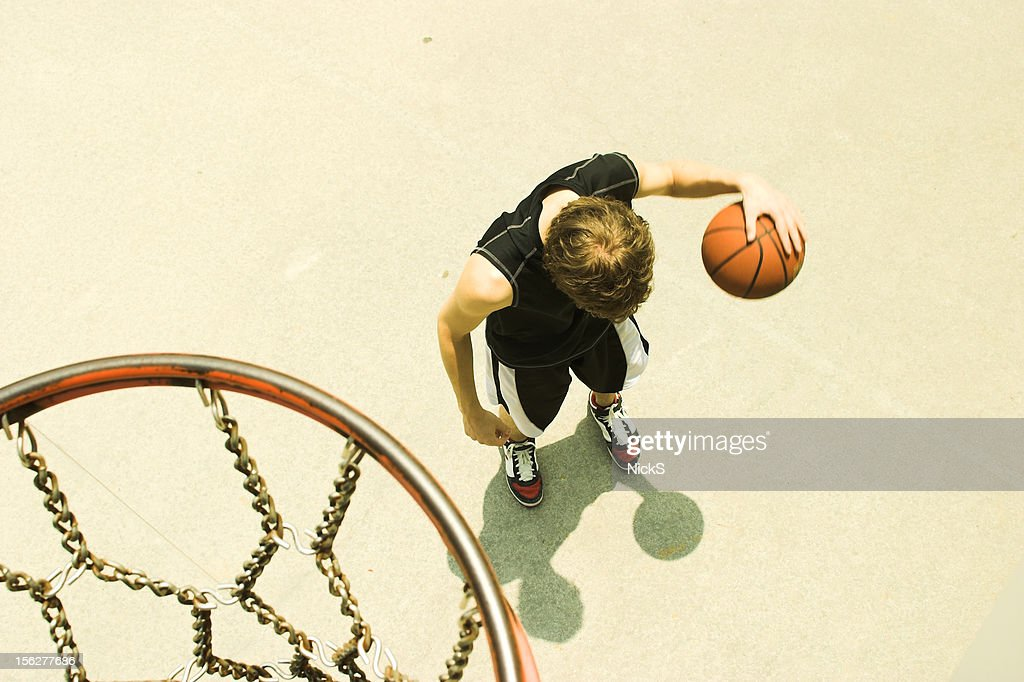 Basketball Hoop with Man Playing : Stock Photo