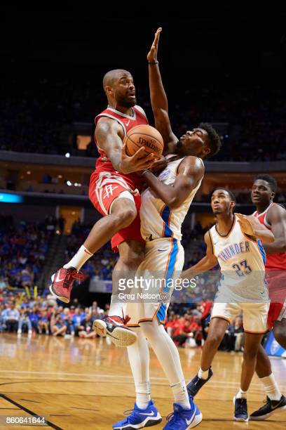 Houston Rockets Houston Rockets Chris Johnson in action vs Oklahoma City Thunder Daniel Hamilton during preseason game at BOK Center Equipment Tulsa...
