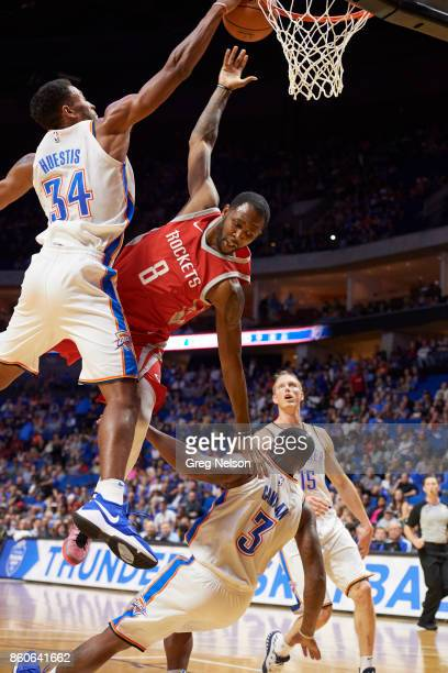 Houston Rockets Houston Rockets Chris Johnson in action vs Oklahoma City Thunder Josh Huestis during preseason game at BOK Center Equipment Tulsa OK...