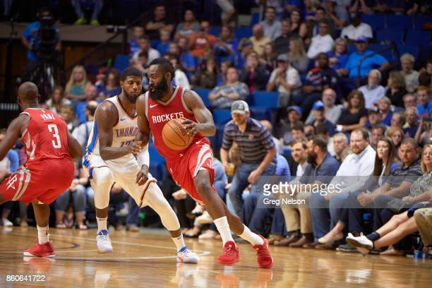 Houston Rockets James Harden in action vs Oklahoma City Thunder Paul George during preseason game at BOK Center Tulsa OK CREDIT Greg Nelson