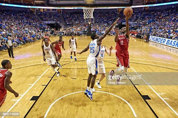 Houston Rockets Luc Mbah a Moute in action layup vs Oklahoma City Thunder Daniel Hamilton during preseason game at BOK Center Tulsa OK CREDIT Greg...