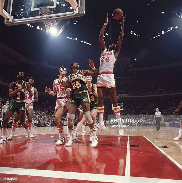 Houston Rockets Moses Malone in action getting rebound vs Seattle SuperSonics Paul Silas View of Rockets Rudy Tomjanovich Houston TX 1/27/1979 CREDIT...