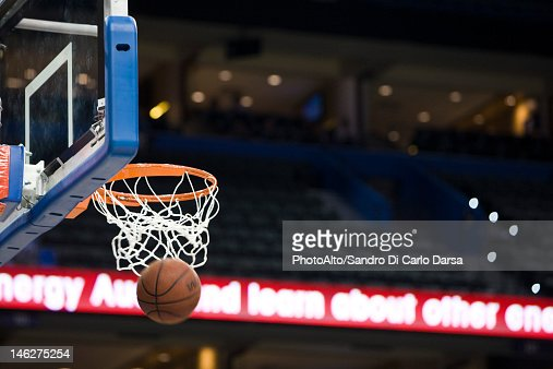 Basketball in hoop, blurred motion