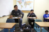Indian Basketball Story Portrait of Satnam Singh Bhamara sitting in his classroom desk during photo shoot at IMG Academy Bhamara a 7'1' teenager from...