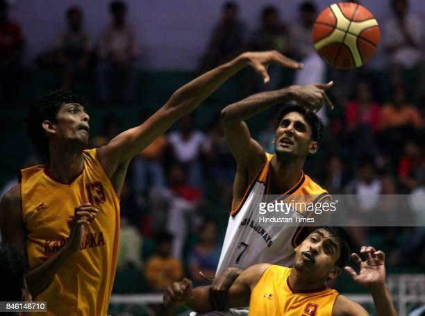 Basketball Indian Railway vs Karnataka Savio Cup basketball match at Don Bosco High School