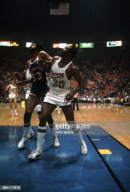 Indiana Pacers George McGinnis during free throw vs Kentucky Colonels Artis Gilmore at Market Sqaure Arena Indianapolis IN CREDIT John Iacono