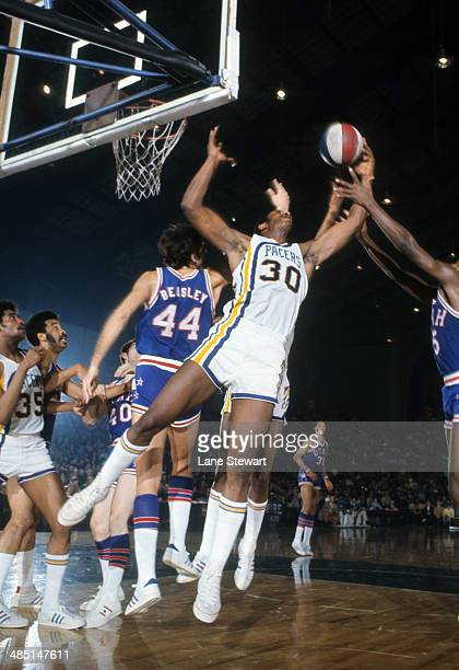 Indiana Pacers George McGinnis in action rebounding vs Utah Stars at Indiana State Fairgrounds Coliseum Indianapolis IN CREDIT Lane Stewart