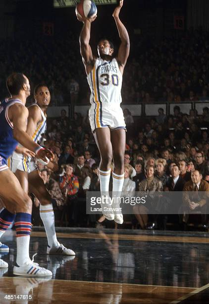 Indiana Pacers George McGinnis in action shot vs Utah Stars at Indiana State Fairgrounds Coliseum Indianapolis IN CREDIT Lane Stewart