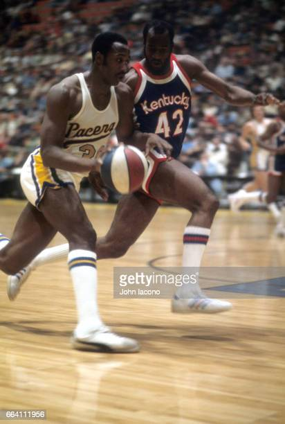 Indiana Pacers George McGinnis in action vs Kentucky Colonels Ronald Thomas at Market Sqaure Arena Indianapolis IN CREDIT John Iacono