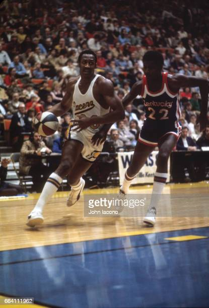Indiana Pacers George McGinnis in action vs Kentucky Colonels Wil Jones at Market Sqaure Arena Indianapolis IN CREDIT John Iacono