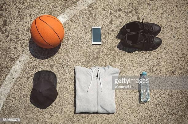 Basketball items lying on ground of basketball court