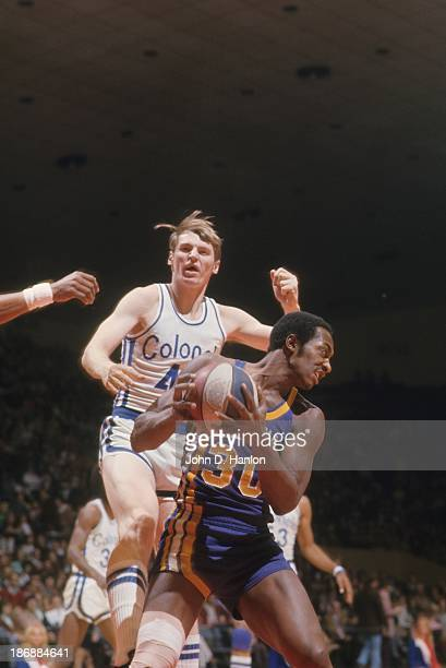 Kentucky Colonels Dan Issel in action vs Indiana Pacers George McGinnis at Freedom Hall Louisville KY CREDIT John D Hanlon