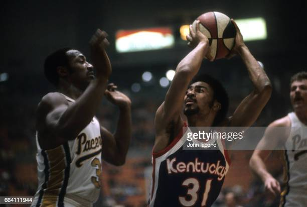 Kentucky Colonels Marv Roberts in action vs Indiana Pacers George McGinnis at Market Square Arena Indianapolis IN CREDIT John Iacono