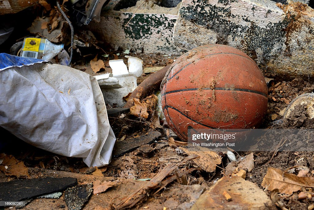 A basketball lays among other rubbish in the back yard of an abandoned home to be bulldozed by Prince George's County in Landover, MD on May 15, 2013. Today officials from Prince George's County gathered with neighborhood civic association representatives and neighbors to watch the demolition of a house that's been vacant over four years. It's also been a troublesome household for over a decade. Legal wrangling has prevented it's earlier demolition. County officials today announced they have a few dozen more they'll be demolishing in the near future.