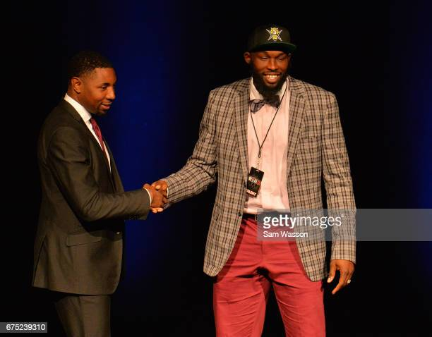 BIG3 basketball league President and Commissioner Roger Mason Jr greets Reggie Evans after he was selected third overall in the 2017 BIG3 draft at...