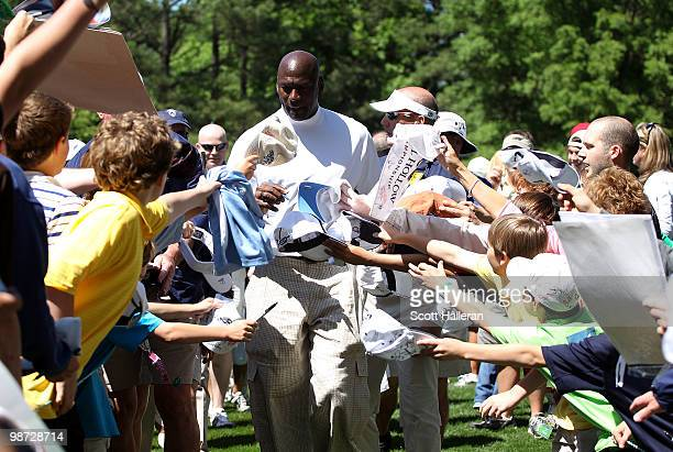 Basketball legend Michael Jordan signs autographs for fans during the pro am prior to the start of the 2010 Quail Hollow Championship at the Quail...