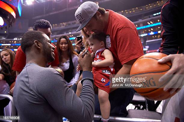Los Angeles Clippers Chris Paul signing autograph for young fan before game vs Oklahoma City Thunder at Staples Center Los Angeles CA CREDIT John W...