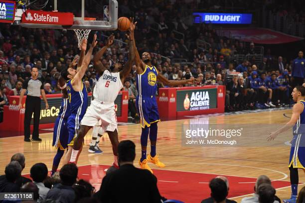 Los Angeles Clippers DeAndre Jordan in action vs Golden State Warriors Kevin Durant and Zaza Puchulia at Staples Center Los Angeles CA CREDIT John W...