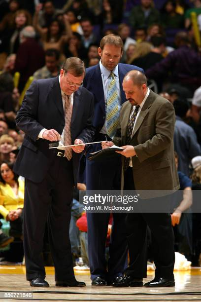 Los Angeles Lakers coaches Frank Hamblen Kurt Rambis and Chris Bodaken on court during game vs Dallas Mavericks at Staples Center Los Angeles CA...