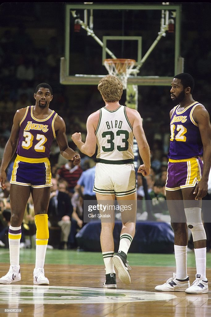 Los Angeles Lakers Magic Johnson (32) in action, fist bump with Boston Celtics Larry Bird (33). View of Lakers James Worthy (42). Boston, MA 1/22/1986