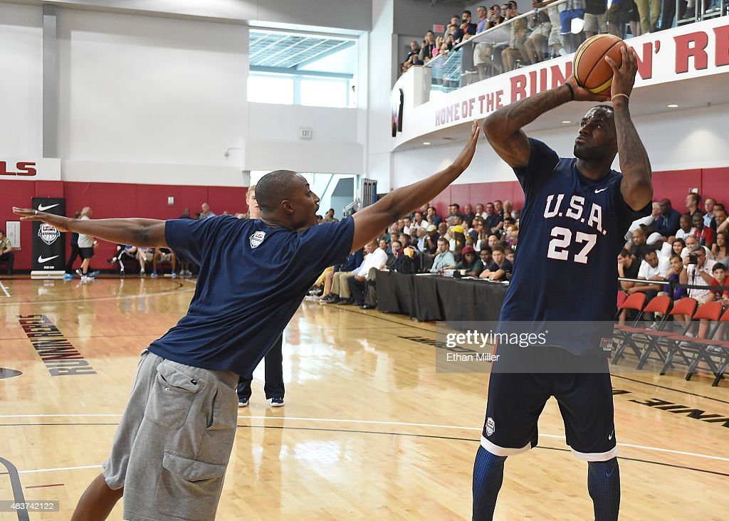 Basketball Men's National Team Assistant Director BJ Johnson guards LeBron James of the 2015 USA Basketball Men's National Team as he shoots during a...