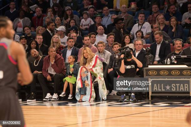 NBA All Star Game Rapper JayZ daughter Blue Ivy Carter and wife singer Beyonce sitting courtside during game at Smoothie King Center New Orleans LA...