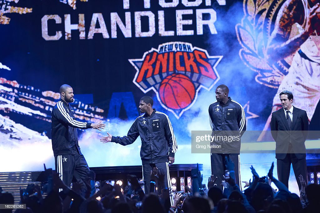 Team East Tyson Chandler (6) of the New York Knickson stage during player introductions before game vs Team West during All-Star Weekend at Toyota Center. View of teammates Kyrie Irving, Luol Deng, and coach Erik Spoelstra. Greg Nelson F6 )