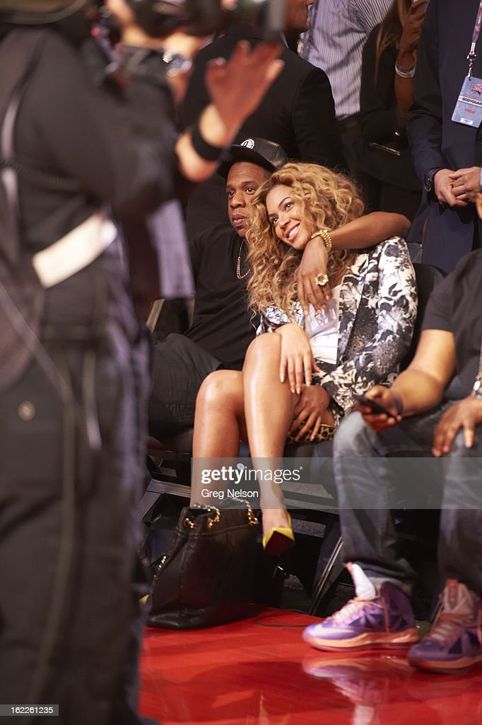 View of celebrities rapper Jay-Z and his wife, singer Beyonce, seated courtside during game during All-Star Weekend at Toyota Center. Greg Nelson F9 )
